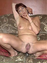 Mature lady showing off her snatch