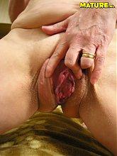 Mature slut showing her wet pussy