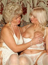 Lingerie clad matures Francesca And Eelene engage in girl on girl sex play and experiment with sex toys live